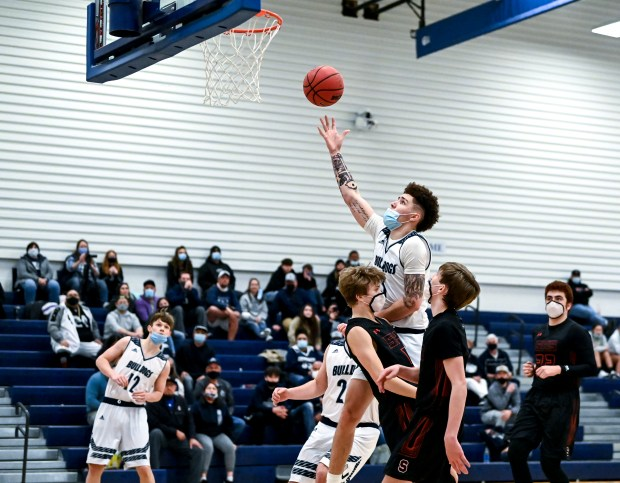 GREELEY, CO - FEBRUARY 26:University's Tayt Chacon (3) shoots during the University Bulldogs boys basketball game against the Strasburg Indians at University Middle School in Greeley Feb. 26, 2021. The Bulldogs fell to the Indians 58-47. (Alex McIntyre/Staff Photographer)