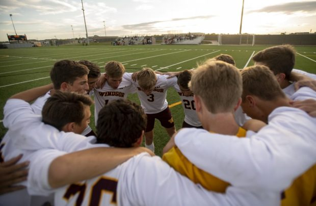 The starters on the Windsor boys soccer team huddle up before a game against Greeley Central on Sept. 26 at District 6 Soccer Stadium in Greeley. (Greeley Tribune file photo)
