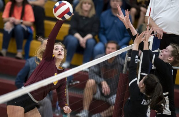 Windsor's Kaylie Phelps goes up for a ball during the Wizards' Class 5A regional match against Highlands Ranch Nov. 9, 2019 at Windsor High School. (Greeley Tribune file photo)