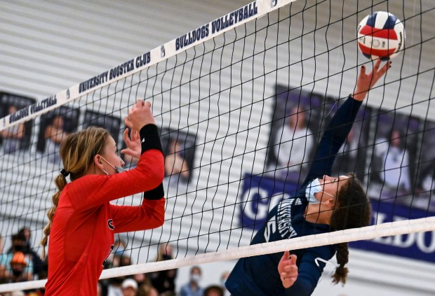 GREELEY, CO - APRIL 06:University's Kylie Williams (5) attacks as Eaton's Rylee Martin (2) leaps to defend during the University Bulldogs volleyball game against the Eaton Reds at University Middle School in Greeley April 6, 2021. The Reds defeated the Bulldogs 3-1. (Alex McIntyre/Staff Photographer)