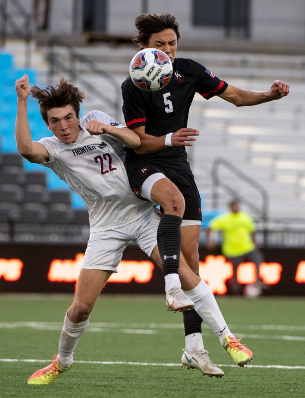 COLORADO SPRINGS, CO - MAY 01:Frontier Academy's Connor Phillips (22) and Colorado Academy's Nico Watters (5) collide as they compete for a header during the Frontier Academy Wolverines 3A boys soccer state championship match against the Colorado Academy Mustangs at Weidner Field in Colorado Springs May 1, 2021. The Wolverines fell to the Mustangs 2-1 in the second overtime period. (Alex McIntyre/Staff Photographer)