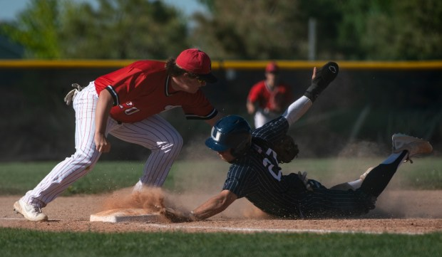 GREELEY, CO - MAY 27:Eaton's Dirk Duncan (20) tags out University's River Jackson (27) at third base during the Eaton Reds baseball game against the University Bulldogs at University High School in Greeley May 27, 2021. The Reds defeated the Bulldogs 12-5. (Alex McIntyre/Staff Photographer)