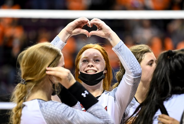COLORADO SPRINGS, CO - MAY 13:Eaton's Abbey Hays (9) flashes a heart symbol to the crowd after the Eaton Reds won their 3A girls volleyball state final match against the Sterling Tigers at The Broadmoor World Arena in Colorado Springs May 13, 2021. The Eaton Reds defeated the Sterling Tigers 3-1 to claim the 3A girls volleyball state title. (Alex McIntyre/Staff Photographer)