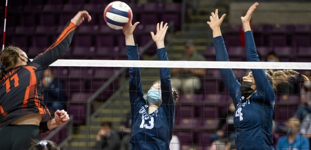 COLORADO SPRINGS, CO - MAY 12:University's Katie Bauer (13) and University's Aesha Alrashed (4) leap to block as Lamar's Sydney Dunning (11) attacks during the University Bulldogs 3A girls volleyball state quarterfinal match against the Lamar Savages at The Broadmoor World Arena in Colorado Springs May 12, 2021. The University Bulldogs defeated the Lamar Savages 3-1 and will advance to the semifinals. (Alex McIntyre/Staff Photographer)