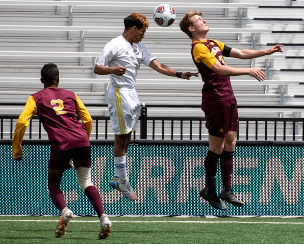 COLORADO SPRINGS, CO - MAY 01:Windsor's John Burnett (3) and a Denver North player leap for a header during the Windsor Wizards 4A boys soccer state championship match against the Denver North Vikings at Weidner Field in Colorado Springs May 1, 2021. The Wizards defeated the Vikings 1-0 to claim their first state title in program history. (Alex McIntyre/Staff Photographer)