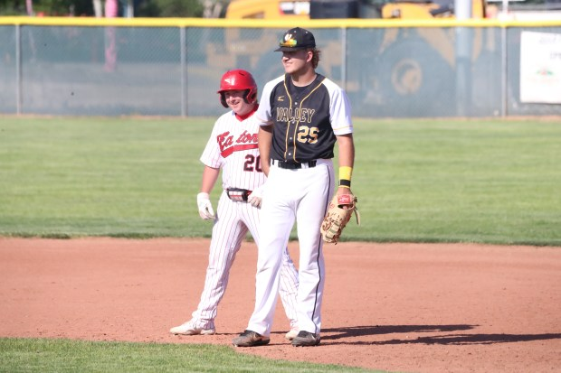 Eaton junior Dirk Duncan, left, and Valley senior Ty Stotts share a lighthearted moment on the bases during the Reds' 10-0 win in a Class 3A Patriot League baseball game on Thursday, June 3, in Eaton. (Courtesy/Brian Stotts)