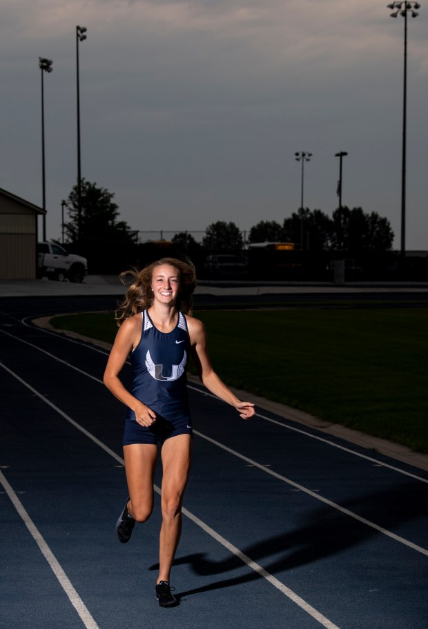 GREELEY, CO - JULY 14:University graduating senior Kylie Kravig runs for a portrait on the track at Tom Roche Field at University Schools in Greeley July 14, 2021. Kravig, who plays girls basketball and competes in both track and cross country, is the Greeley Tribune's 2021 Girls Athlete of the Year. (Alex McIntyre/Staff Photographer)