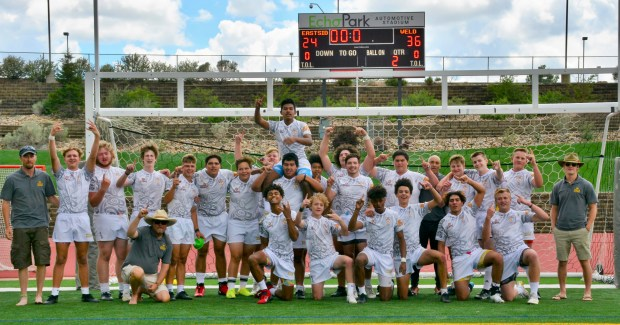 Weld Rugby poses in front of the scoreboard after winning the Division II state championship with a 36-24 win against Eastside on June 26 at EchoPark in Parker. (Courtesy/Weld Rugby)