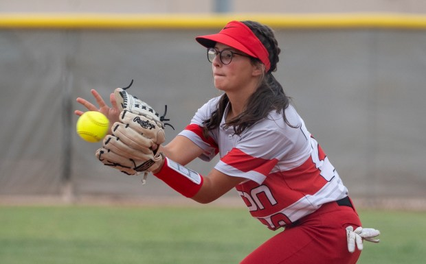 EATON, CO - AUGUST 17:Eaton's Jaeli Lewis (20) makes the catch to tag out a Fort Lupton runner at first base during the Eaton Reds softball game against the Fort Lupton Bluedevils at Eaton High School in Eaton Aug. 17, 2021. The Eaton Reds defeated the Fort Lupton Bluedevils 6-1. (Alex McIntyre/Staff Photographer)