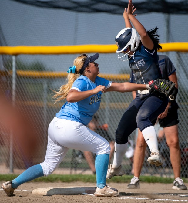 GREELEY, CO - AUGUST 12:Greeley West first baseman Brooke Hernandez (10) tries to tag out Northridge short stop Jayah Tellez (17) but Tellez is ruled safe during the Northridge Grizzlies softball game against the Greeley West Spartans at District 6 Softball Field in Greeley Aug. 12, 2021. The Grizzlies defeated the Spartans 12-0 in four innings. (Alex McIntyre/Staff Photographer)