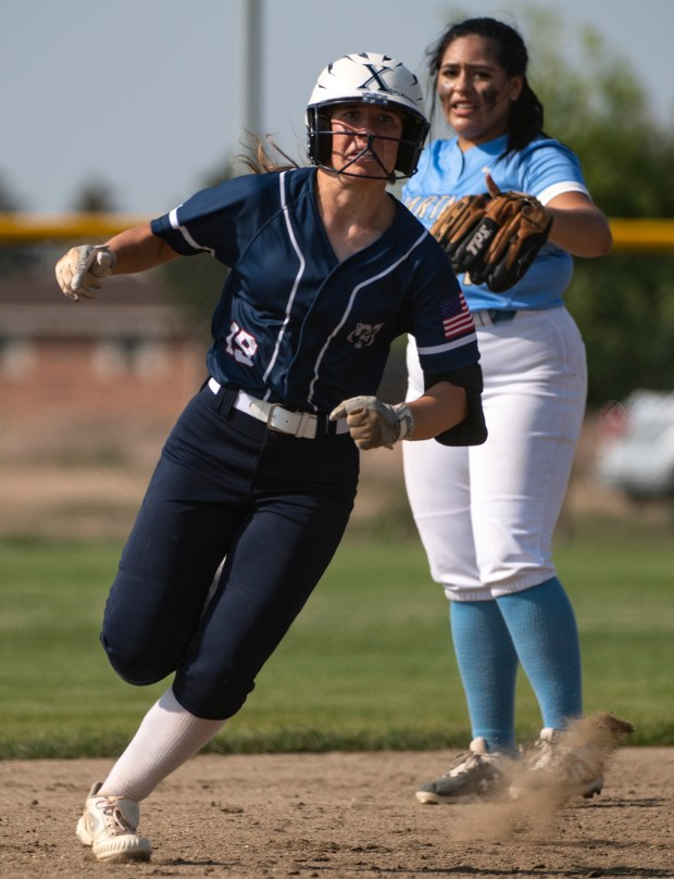 GREELEY, CO - AUGUST 12:Northridge outfielder Kennedy Strausheim (19) rounds second on her way to third during the Northridge Grizzlies softball game against the Greeley West Spartans at District 6 Softball Field in Greeley Aug. 12, 2021. The Grizzlies defeated the Spartans 12-0 in four innings. (Alex McIntyre/Staff Photographer)