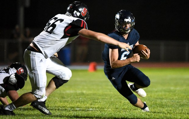 KERSEY, CO - AUGUST 27:Strasburg's Wilson Ames (66) wraps up Platte Valley's Logan Curtis-Scaramuzzo (6) during the Platte Valley Broncos football game against the Strasburg Indians at Platte Valley High School in Kersey Aug. 27, 2021. The Broncos defeated the Indians 18-7. (Alex McIntyre/Staff Photographer)
