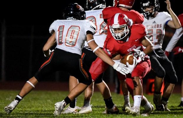 EATON, CO - SEPTEMBER 02:Eaton's Benson Hood (26) slips by Sterling's Gage Parker (10) during the Eaton Reds football game against the Sterling Tigers at Eaton High School in Eaton Sept. 2, 2021. The Reds defeated the Tigers 63-0. (Alex McIntyre/Staff Photographer)