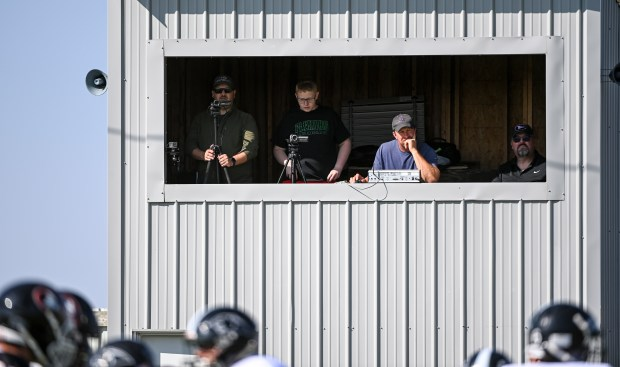 GROVER, CO - SEPTEMBER 17:People watch and film from the press box during the Pawnee Coyotes 1A 6-man football game against the Fleming Wildcats at Pawnee High School in Grover Sept. 17, 2021. The Pawnee Coyotes fell to the Fleming Wildcats 70-0. (Alex McIntyre/Staff Photographer)