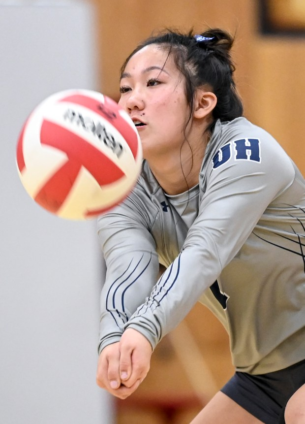 EATON, CO - SEPTEMBER 28:University's Jayden Nation (1) digs during the Eaton Reds volleyball match against the University Bulldogs at Eaton High School in Eaton Sept. 28, 2021. (Alex McIntyre/Staff Photographer)