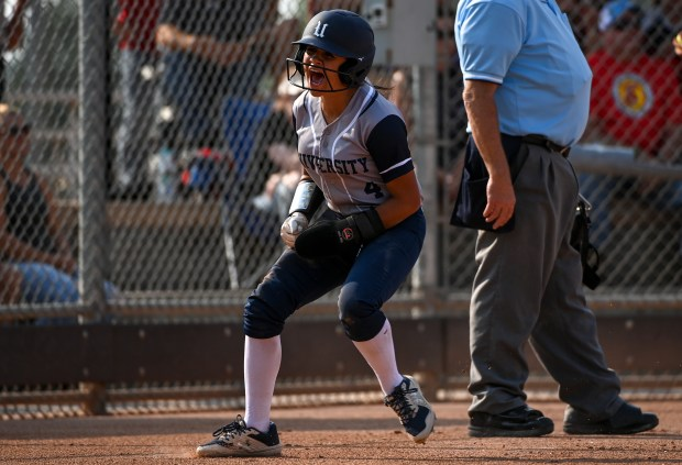 GREELEY, CO - SEPTEMBER 07:University's Ellie Baca (4) reacts after scoring during the University Bulldogs softball game against the Eaton Reds at Twin Rivers Ballparks in Greeley Sept. 7, 2021. The Reds defeated the Bulldogs 6-4. (Alex McIntyre/Staff Photographer)