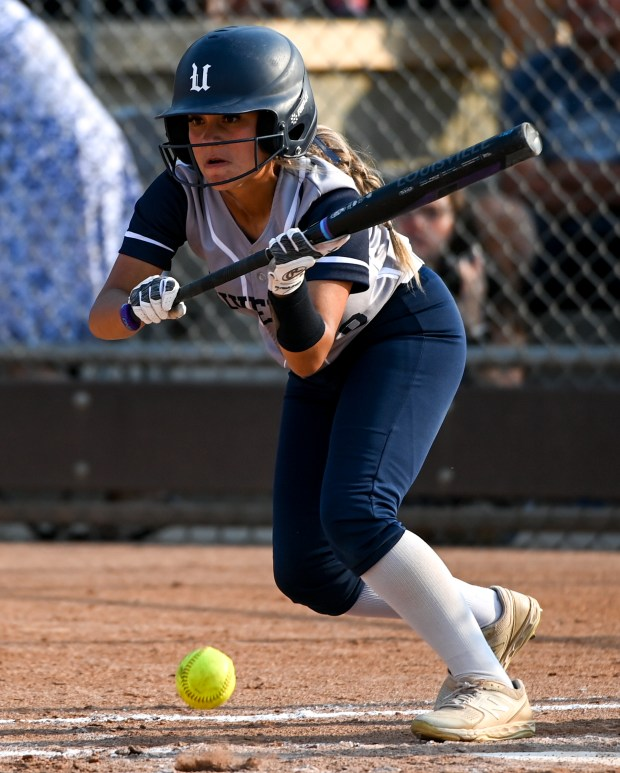 GREELEY, CO - SEPTEMBER 07:University's Kaitlynn Baca (6) bunts during the University Bulldogs softball game against the Eaton Reds at Twin Rivers Ballparks in Greeley Sept. 7, 2021. The Reds defeated the Bulldogs 6-4. (Alex McIntyre/Staff Photographer)