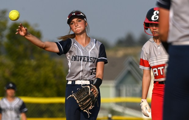 GREELEY, CO - SEPTEMBER 07:University's Kaden Wyatt (13) throws the ball back to University's Addison Harding (5) after she just missed tagging out Eaton's Blayke Duncan (1) at second base during the University Bulldogs softball game against the Eaton Reds at Twin Rivers Ballparks in Greeley Sept. 7, 2021. The Reds defeated the Bulldogs 6-4. (Alex McIntyre/Staff Photographer)
