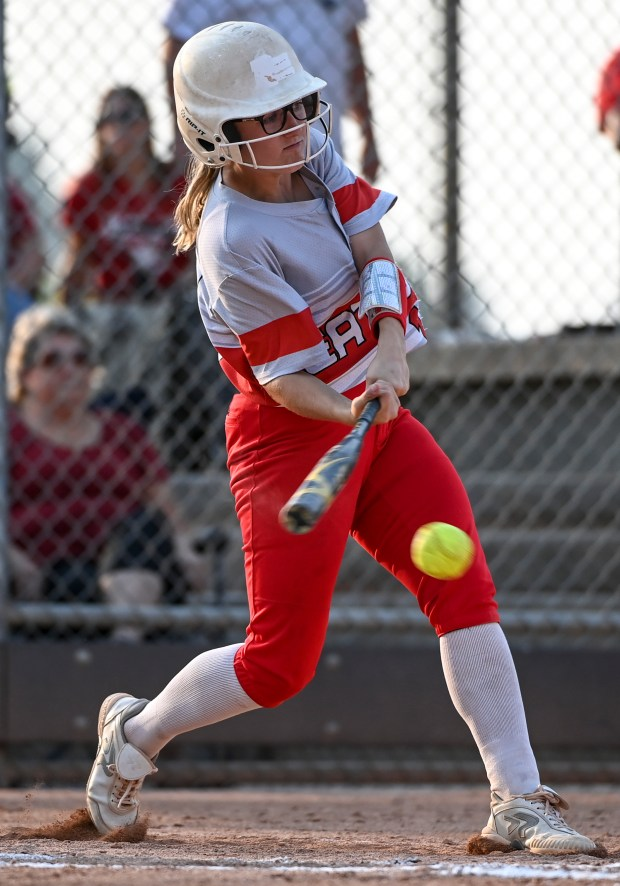 GREELEY, CO - SEPTEMBER 07:Eaton's Stephanie Bingley (18) hits and bats in Eaton's Kiauna Smith (3) during the University Bulldogs softball game against the Eaton Reds at Twin Rivers Ballparks in Greeley Sept. 7, 2021. The Reds defeated the Bulldogs 6-4. (Alex McIntyre/Staff Photographer)