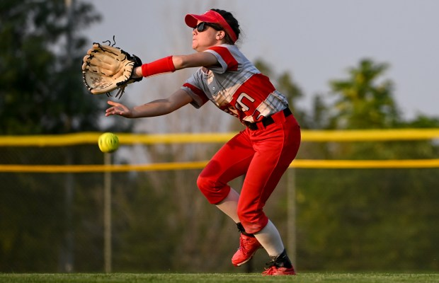 GREELEY, CO - SEPTEMBER 07:Eaton's Shelby Pribelsky (6) just misses catching University's Aspyn Hikida (14)'s fly ball to the outfield during the University Bulldogs softball game against the Eaton Reds at Twin Rivers Ballparks in Greeley Sept. 7, 2021. The Reds defeated the Bulldogs 6-4. (Alex McIntyre/Staff Photographer)