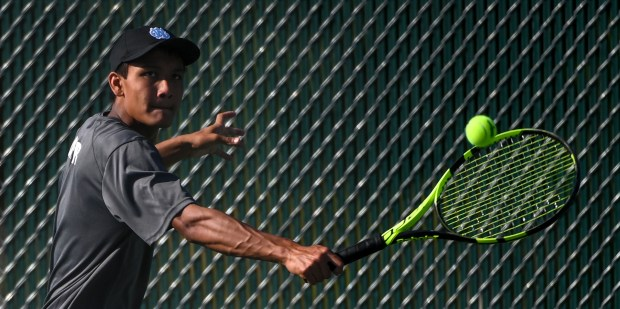GREELEY, CO - SEPTEMBER 14:Greeley West's Alex Dhupar, center, plays against Greeley Central's Reid Richardson in No. 2 singles during the Greeley Central Wildcats boys tennis match against the Greeley West Spartans at Greeley Central High School in Greeley Sept. 14, 2021. (Alex McIntyre/Staff Photographer)