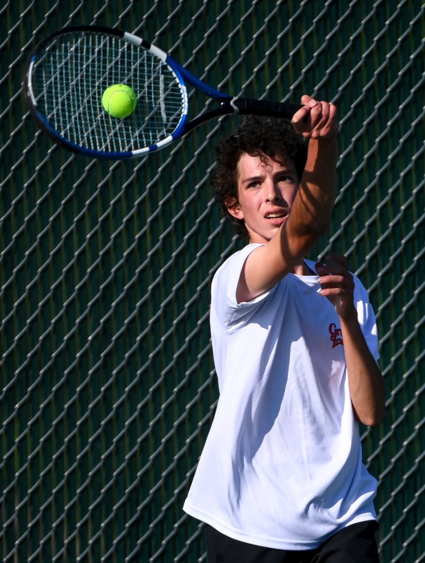 GREELEY, CO - SEPTEMBER 14:Greeley Central's Ayden Mascarenas, center, plays against Greeley West's Cole Bartels during the Greeley Central Wildcats boys tennis match against the Greeley West Spartans at Greeley Central High School in Greeley Sept. 14, 2021. (Alex McIntyre/Staff Photographer)