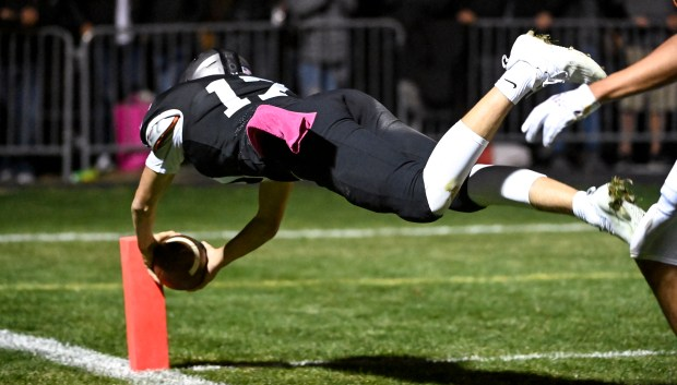JOHNSTOWN, CO - OCTOBER 08:Roosevelt's Brock Saya (17) dives for the pylon as he runs on a keeper during the Roosevelt Roughriders football game against the Mead Mavericks at Roosevelt High School in Johnstown Oct. 8, 2021. The Roughriders defeated the Mavericks 37-7. (Alex McIntyre/Staff Photographer)