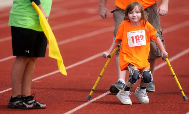 6-year-old Anya Wild smiles as she examines one of her ribbons she won in the Special Olympics on May 9 at the District 6 stadium. It was Anya's first time competing in the Special Olympics.