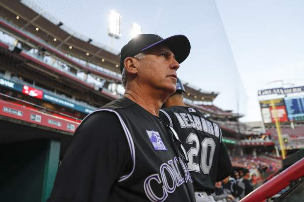 Colorado Rockies manager Bud Black watches from the dugout during the fourth inning of the team's baseball game against the Cincinnati Reds, Wednesday, June 6, 2018, in Cincinnati. (AP Photo/John Minchillo)