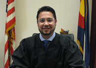 Ryan Kamada, after taking the bench in 2015 as a Weld County magistrate
