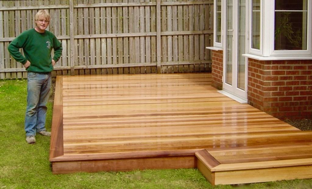 Cedar wood garden decking in Darlington - Green Onion ... on Wooded Backyard Ideas id=14969