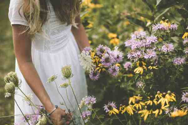 Woman in flower field natural dryer sheet alternative