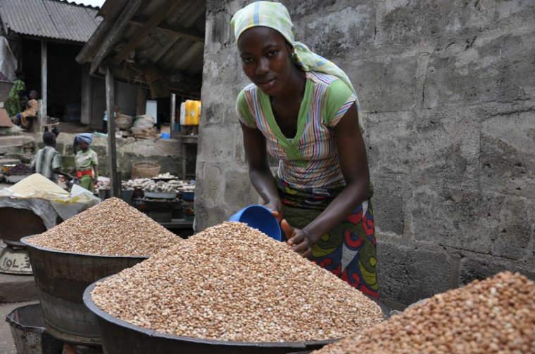 Woman selling cowpeas in Bodija market, Ibadan, Nigeria