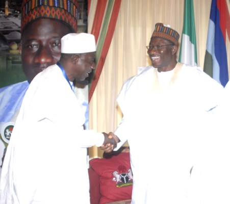 Ozi in handshake with President Jonathan