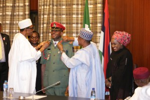 PRESIDENT BUHARI DECORATES HIS ADC  1. President Muhammadu Buhari and Minister of Defence, Brig General Mansur Dan Ali decorates  ADC to the President to the rank of Col Mohammed.Lawal Abubakar supported by the wife, Fatima Daura Abubakar at the Presidential Villa in Abuja. PHOTO; SUNDAY AGHAEZE.
