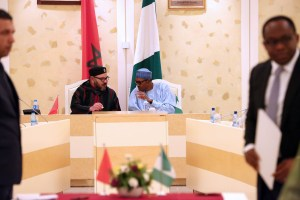 MOU ON TRADE AGREEMENT 4A President Muhammadu Buhari Chats with King of Morocco, His Majesty Mohammed VI during the signing 17 trade agreements on investment, Air Transportation, agriculture and other cooperation at the Presidential Villa Abuja. PHOTO; SUNDAY AGHAEZE. DEC 3 2016.