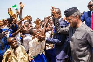 Acting President, Prof. Yemi Osinbajo waving school children in Kebbi state