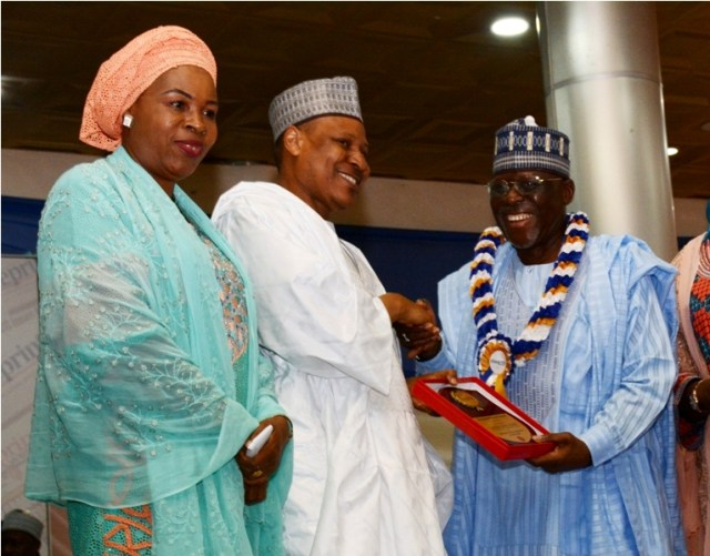 Blueprint newspaper honours distinguished nigerians greenbarge former governor of kogi state captain idris wada right receiving the blueprints distinguished award in patriotism from chairman blueprint newspapers malvernweather Images
