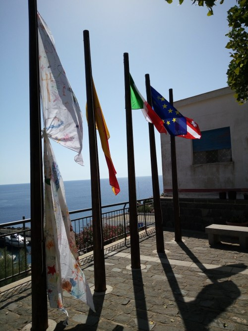 Flags! From right to left: DAN Europe, European Union, Italy, Sicily and a special flag dedicated to the sea crafted by local kids