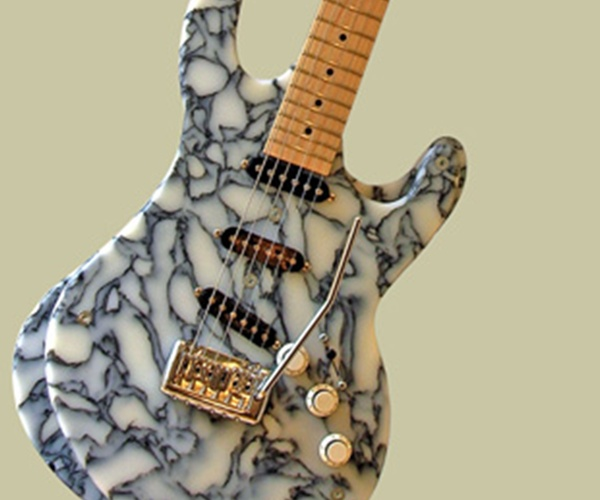5 creative guitars made from recycled materials green for Things to make out of recycled stuff