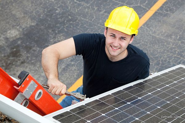 Electrician Installs Solar Panel