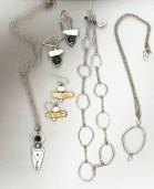 Hand built silver jewelry by (l) Hope Konecy and (r) Dennis Jean and other artisans.