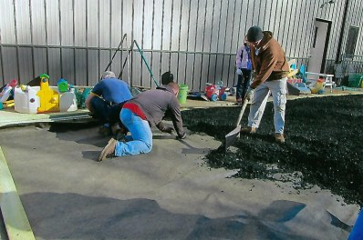 Installation of rubber mulch at Bright Beginnings Daycare, funded by the Foundation's Community Support Grant.