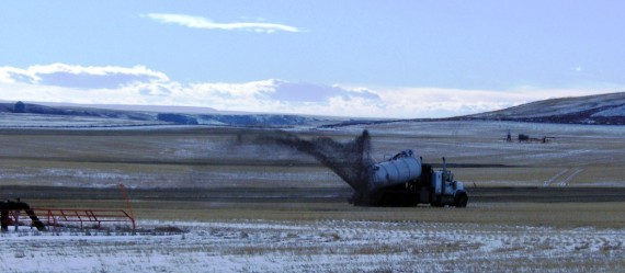Fracking waste being spread on Albertan fields near a natural gas facility fracking at Rosebud, Alberta
