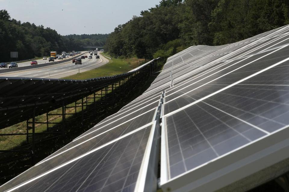 Two solar farms alongside the Mass. Pike contain 2,100 panels each. Photo by Joanne Rathe/Globe Staff