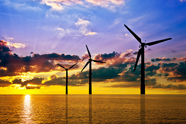 Silhouette of wind power stations over the sea at sunset (Photo: Bureau of Ocean Energy Management)