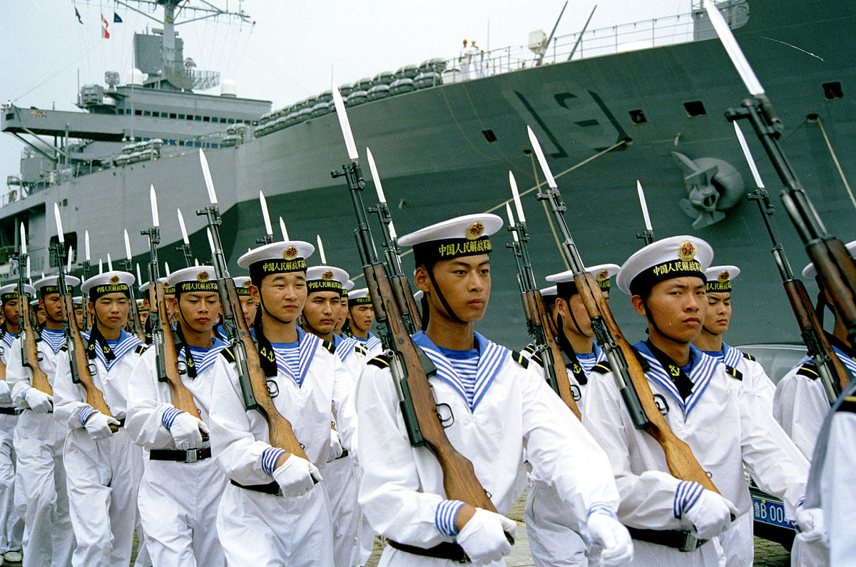 In a photograph taken in Yokosuka, Japan in 2000, sailors of the Peoples Republic of China march past USS Blueridge, (Photo by Jiang, CC BY SA, Wikimedia Commons)