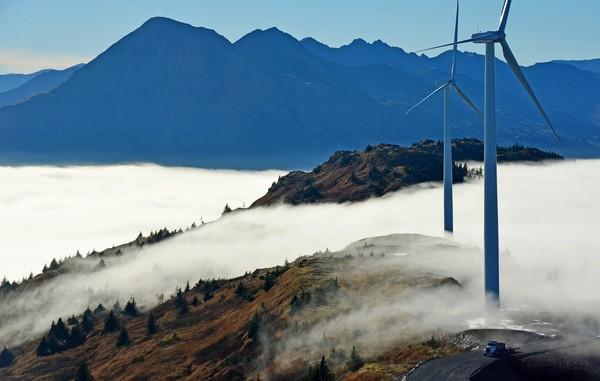 Wind turbines in Kodiak (AP Photo / Kodiak Daily Mirror, James Brooks)