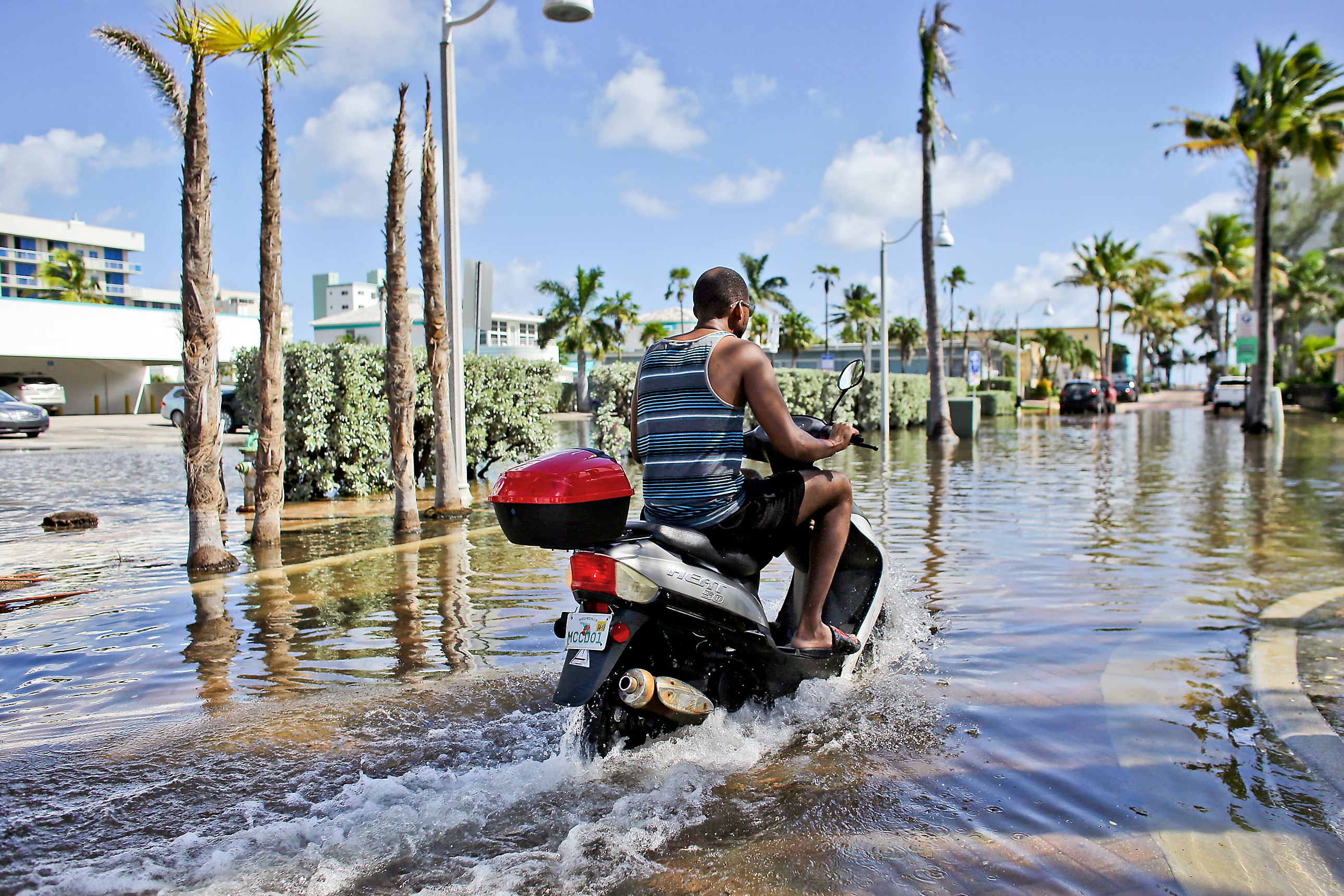 With rising seas, sunny day flooding in Hollywood, Florida (AP)
