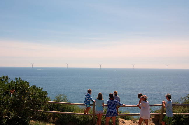 Tourists on Block Island taking in the view of the wind farm (Credit: Phil McKenna | InsideClimate News)